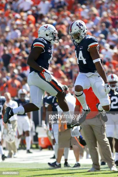 Olamide Zaccheaus and Andre Levrone of the Virginia Cavaliers celebrate a touchdown during a game against the Duke Blue Devils at Scott Stadium on...