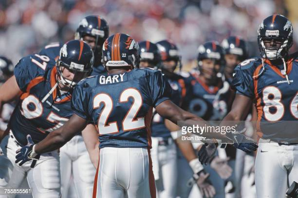 Olandis Gary Running Back for the Denver Broncos runs onto the field and is greeted by his team mates before their American Football Conference West...