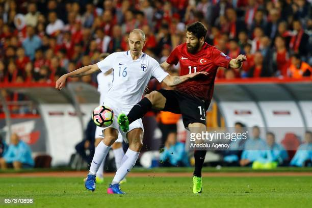 Olcay Sahan of Turkey in action against Sakari Mattila of Finland during the 2018 FIFA World Cup Qualification match between Turkey and Finland at...