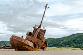Rusty shipwreck on the shores of beach