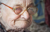 Portrait of an elderly woman. Expressive facial features. Kindness and mercy. Assisting the elderly in old age