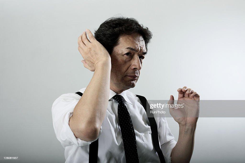 old age businessman adjusting his hair