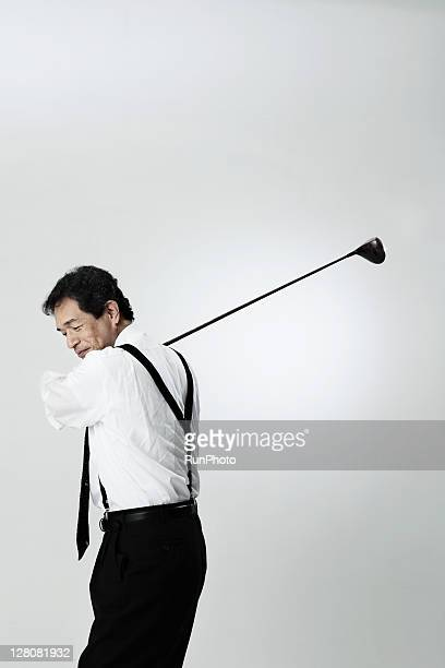 old age businessman playing golf