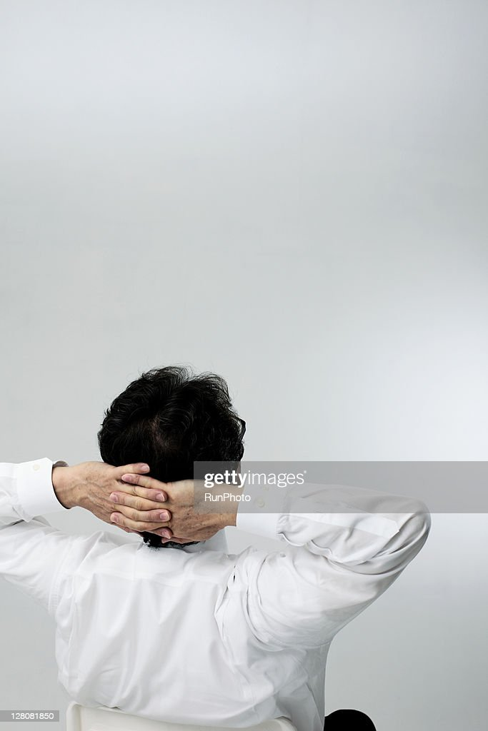 old age businessman relaxing,rear view