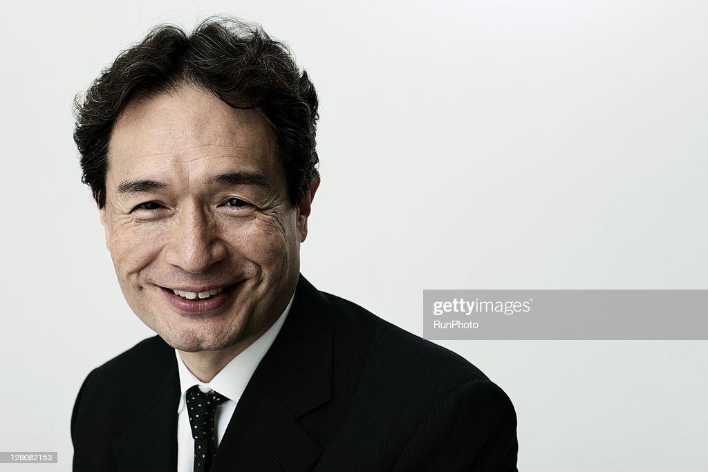 old age businessman smiling,portrait