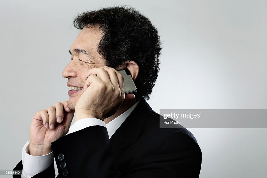 old age businessman talking on mobile phone