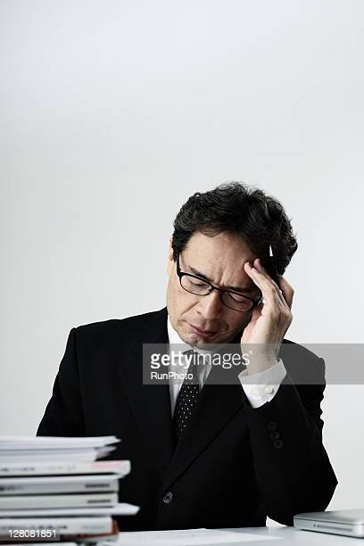 old age businessman thinking at the desk