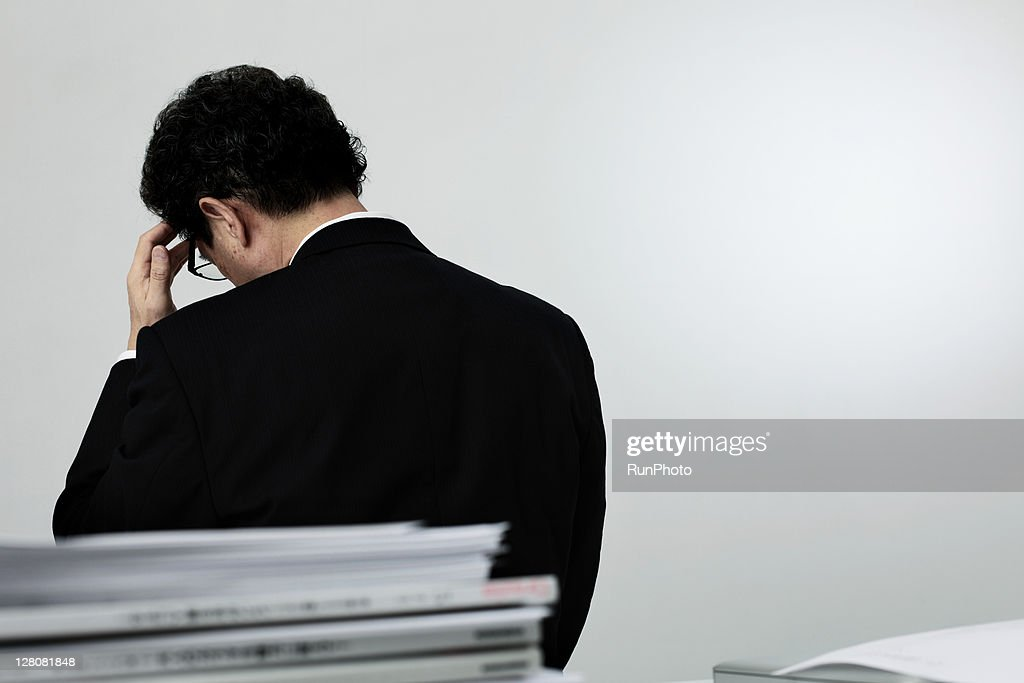 old age businessman thinking,rear view