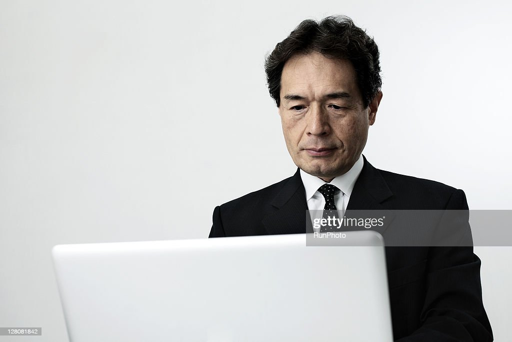 old age businessman with a personal computer