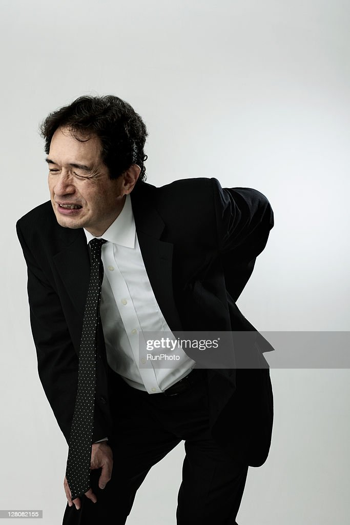 old age businessman with back pain