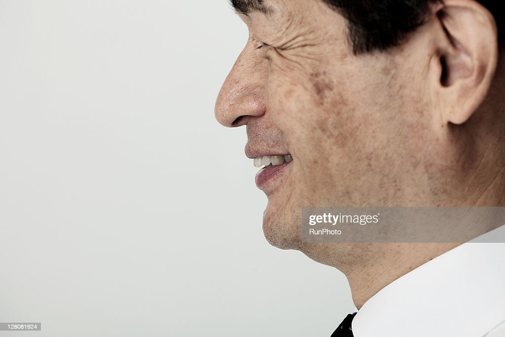 old age businessman'ssmile,profile