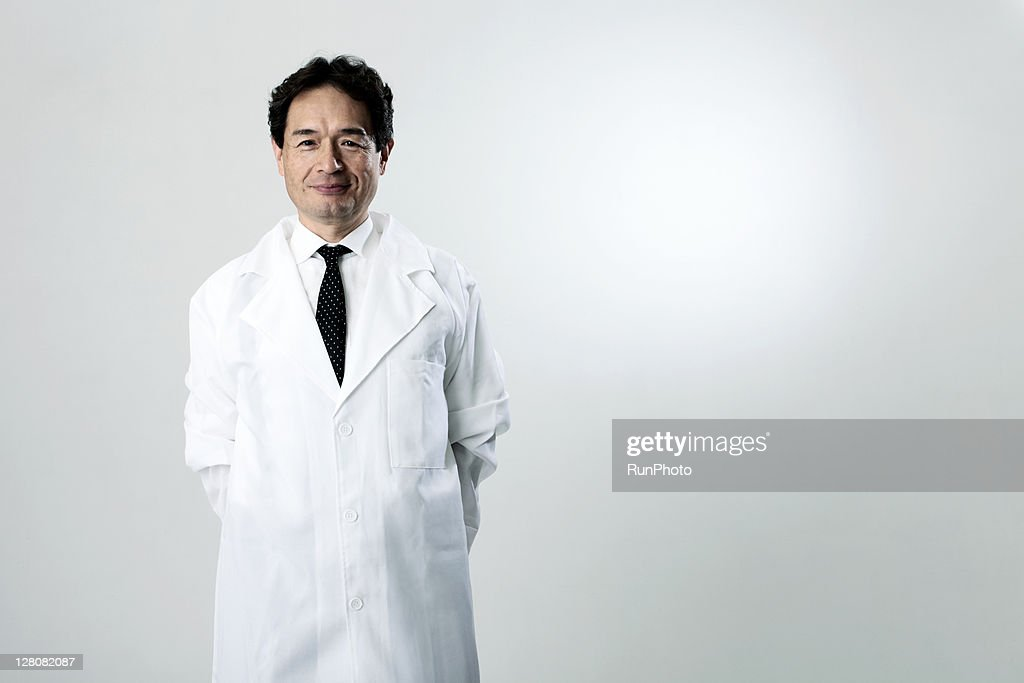 old age doctor smiling,portrait
