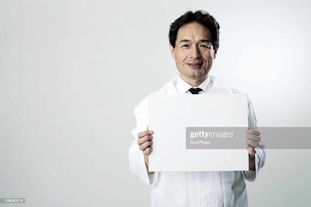 old age doctor with a whiteboard