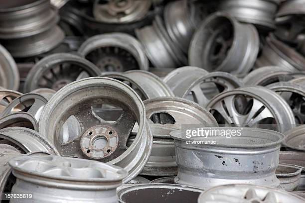 Old aluminum car wheel rims ready for recycling.