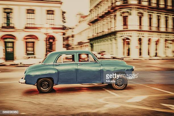 Old American car driving at a street of Havana, Cuba