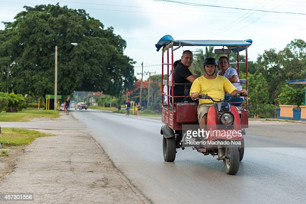 Old American car transporting passengers in Cuba where transportation is an issue and expensive to many