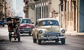 Old American cars are seen in a street of Havana on December 19 2014 AFP PHOTO/ Yamil LAGE / AFP / YAMIL LAGE
