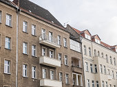 Architectural Exterior of Old and New Low Rise Residential Urban Apartment Buildings with Balconies Under Overcast Sky