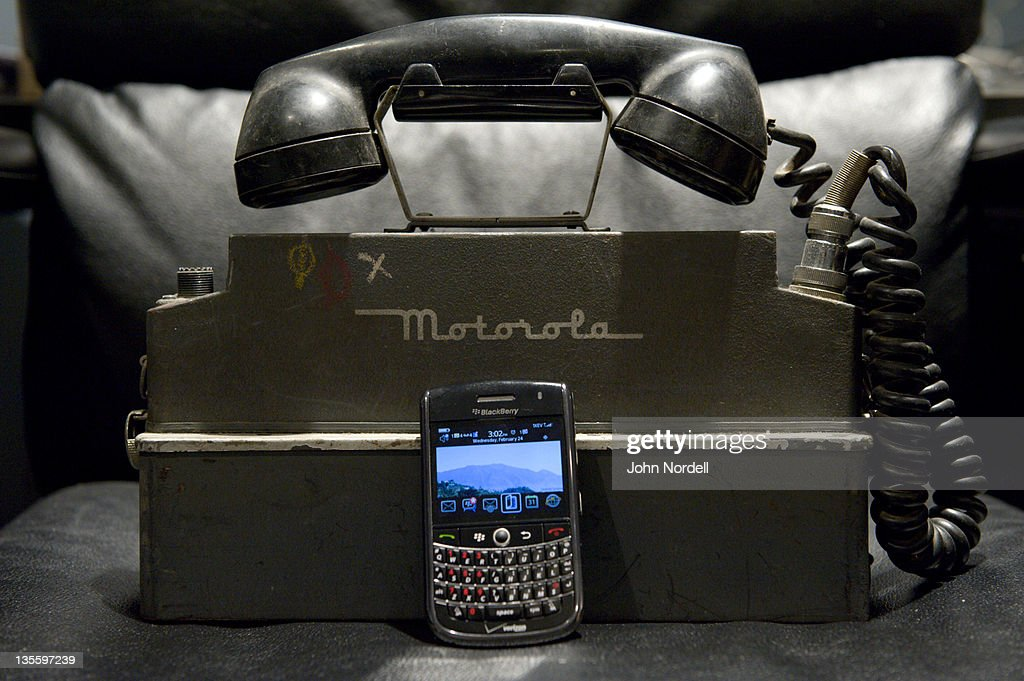 Old and new devices for communicating from Motorola and Blackberry : Stock Photo
