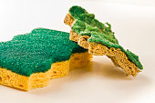 Old and new sponges for household cleaning of kitchen and bathroom