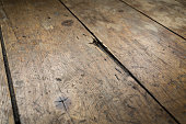 Old, worn and repaired wooden Victorian floorboards.