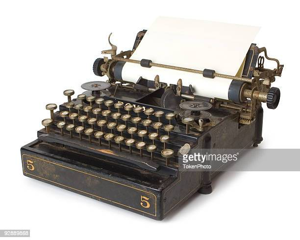 A old antique typewriter with blank paper