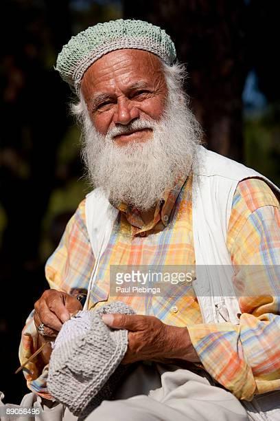old arab man knitting