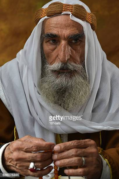 Old Arabic man portrait with traditional clothes