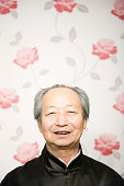 Old Asian man smiling