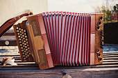 One old Austrian accordion, details of decoration.
