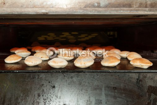 Old Baking Oven With Pita Bread Stock Photo