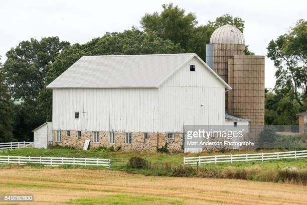 Old barn on rolling farm field prairie in Midwest Wisconsin.
