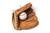 Old baseball with a baseball glove isolated on a white background