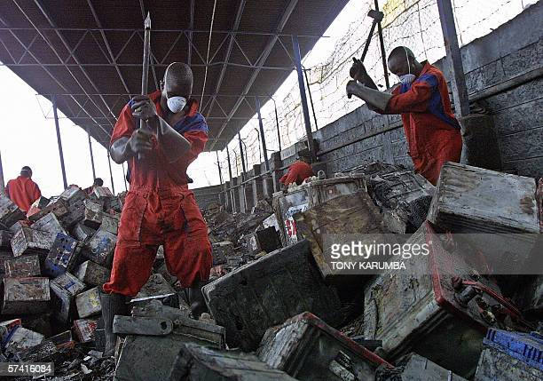 Old batteries are broken to extract lead components in this 19 April 2006 photo at a car battery dump at Athi River Machakos district of Kenya Stiff...