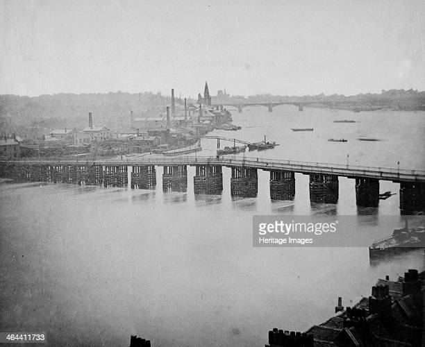 Old Battersea Bridge Wandsworth London c1861c1881 looking southwest towards the Battersea Railway Bridge with the spire of St Mary Battersea also...