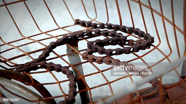 Old Bicycle Chain On Rusty Metal Grid