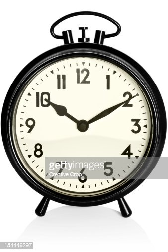 Old Black Alarm Clock Showing 1010am Pm Stock Photo