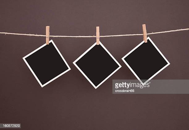 old blank photos hanging on clothesline with clipping path