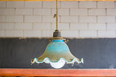 Old blue vintage lamp ceiling with white and black brick wall