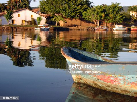 Old boat on Paraty River : Stock Photo