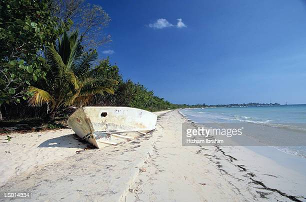 Old Boat Wrecked on a White Sand Beach