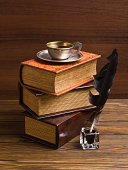 old books and pen on a wooden table