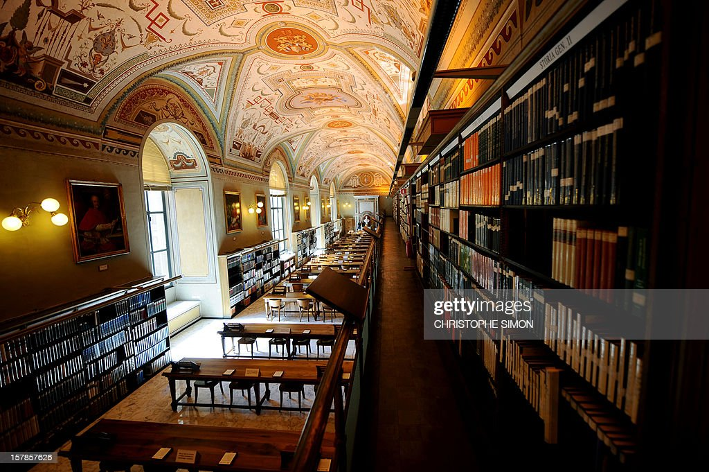 Old books are displayed in the Apostolic Library of the Vatican on September 13, 2010, after its reopening. The Vatican's Apostolic Library reopened to scholars following a three-year renovation to improve its cataloguing and security.