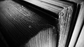 Dusty old books in black and white