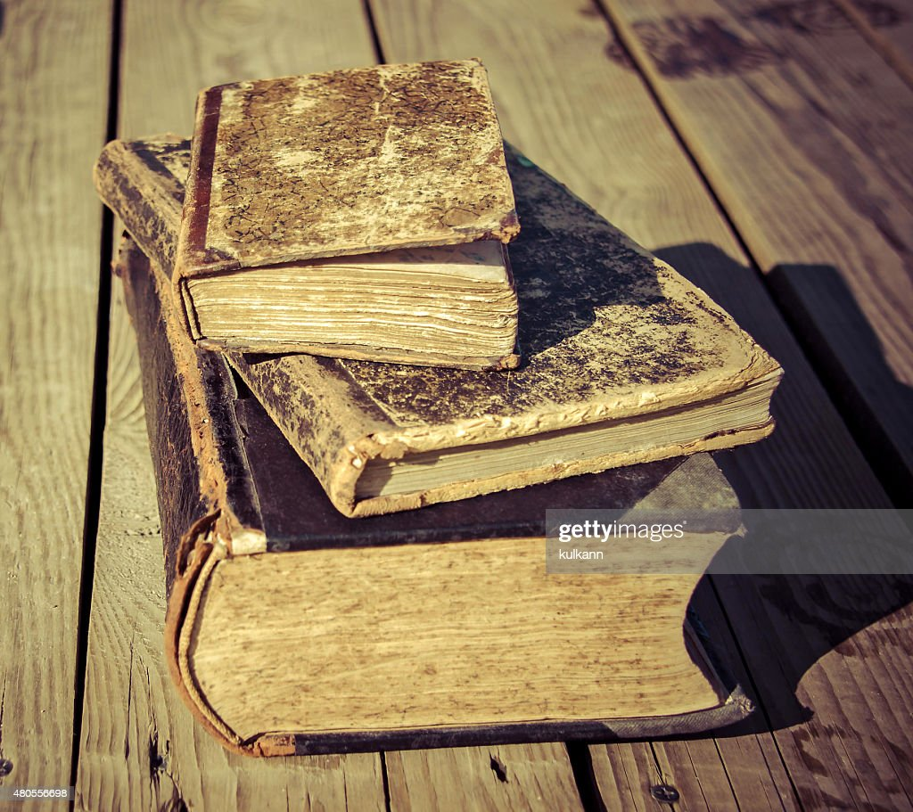 old books on a wooden floor terrace : Stock Photo