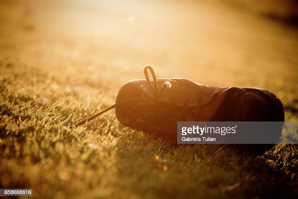 Old boots abandoned in grass