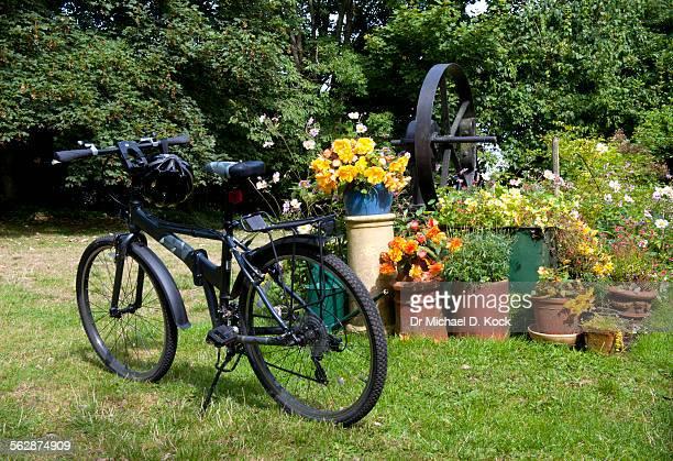 Old borehole, bicycle and English garden, Providence House, Kent, UK