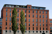 An old brick building converted into lofts and working offices in Montreal.  Downtown Montreal office buildings and architecture. Check out my