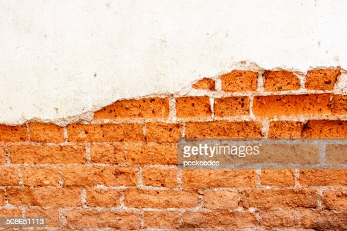 old brick wall cracked concrete vintage  background : Stock Photo