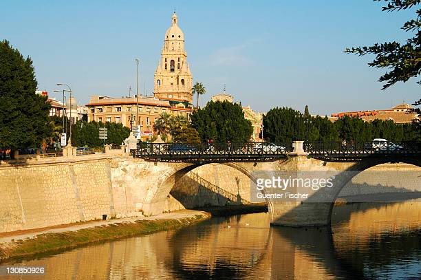 Old bridge across the Rio Segura river and spire of the cathedral Murcia Spain